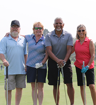 A group at the Westy Ranum alumni golf tournament