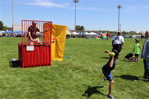 Kid throws a ball at the dunk tank during the 2019 WPS Back-to-School BBQ