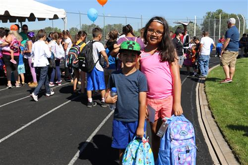 A boy student and a girl student at the 2019 WPS Back-to-School BBQ
