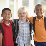 picture of three boys wearing backpacks