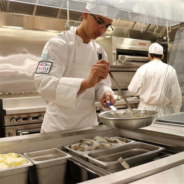 student cooking in the new prostart kitchen