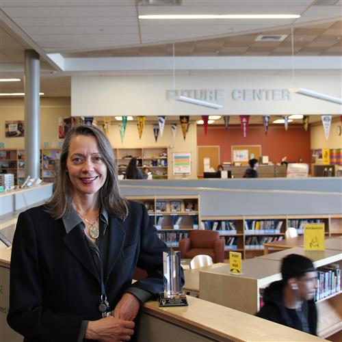 sandy steiner with her award in the westminster high school library