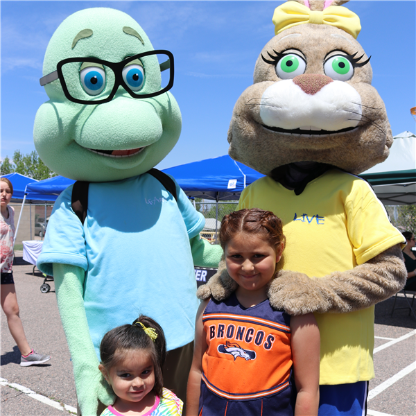 chartwells mascots and two little girls smiling