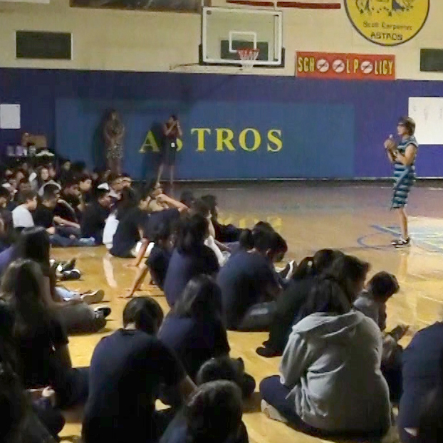 Sylvia Acevedo talks to students in the gym