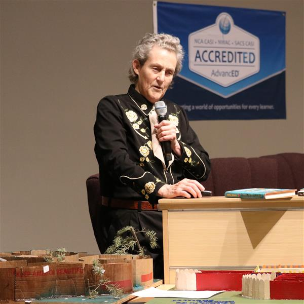 temple grandin speaks into a microphone