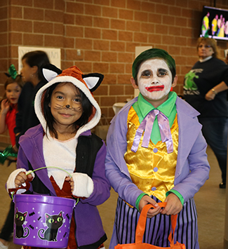 Two kids dressed up for halloween at the 2018 district showcase