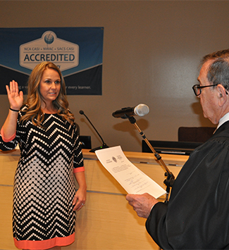 Christine Martinez being sworn in to Board of Education