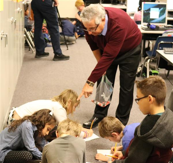 math tutor Nik Nikmanesh works with students at mesa elementary