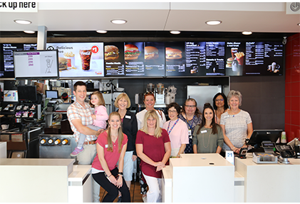 Mesa staff and McDonald's staff pose for a picture