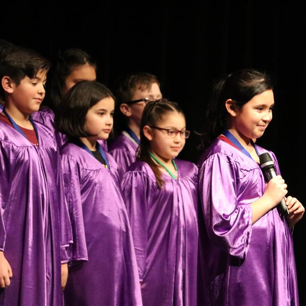 students in purple robes perform at Celebrating Excellence!