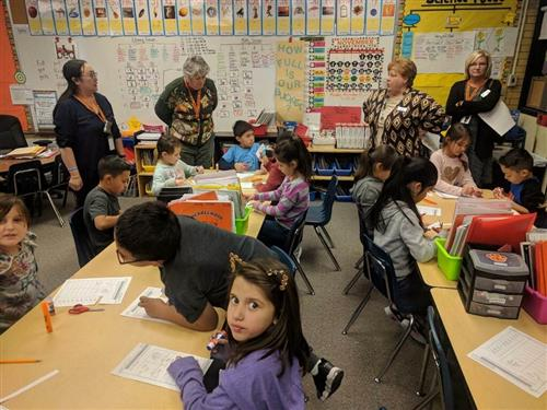 sen. todd and cindy davis tour a classroom where children are working