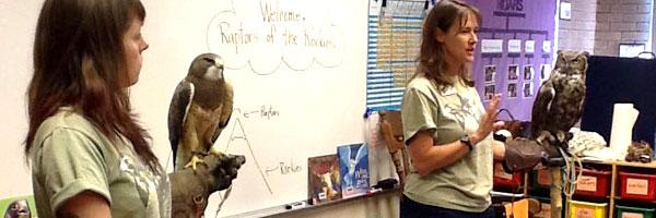 two instructors from Raptors of the Rockies holding two birds