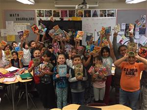 Students holding books in Skyline Vista Elementary classroom