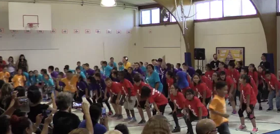 students dancing for their parents and families