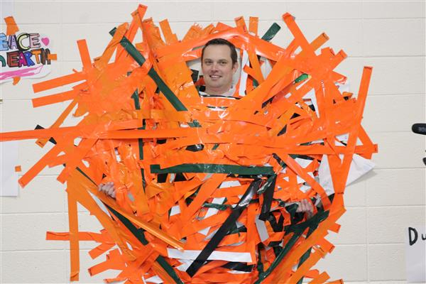 principal zack white taped to a wall