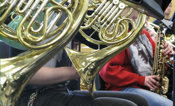 group of students playing tubas