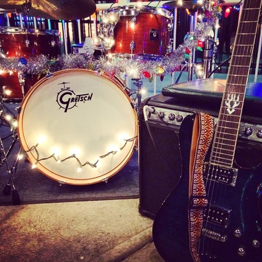 picture of a guitar and a drum set