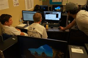 Students working with computers at Cyber Security Competition
