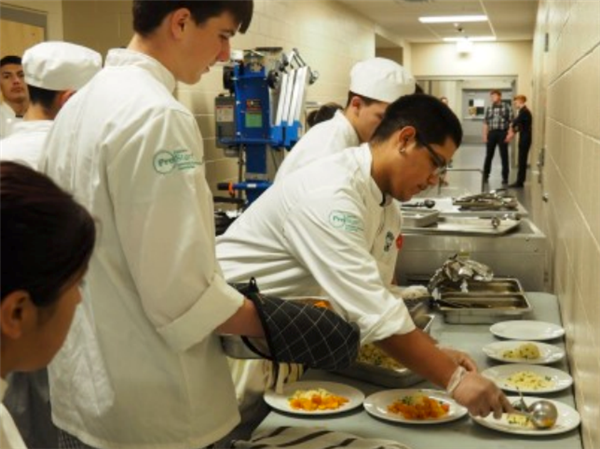 students serving meals during the first Prostart Dinner Theater
