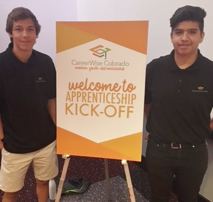 Two Westy Students Posing with Welcome to Apprenticeship Kick-Off Sign