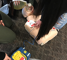 students taking part in a CPR class