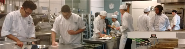 students at MSU Denver working in a food prep kitchen