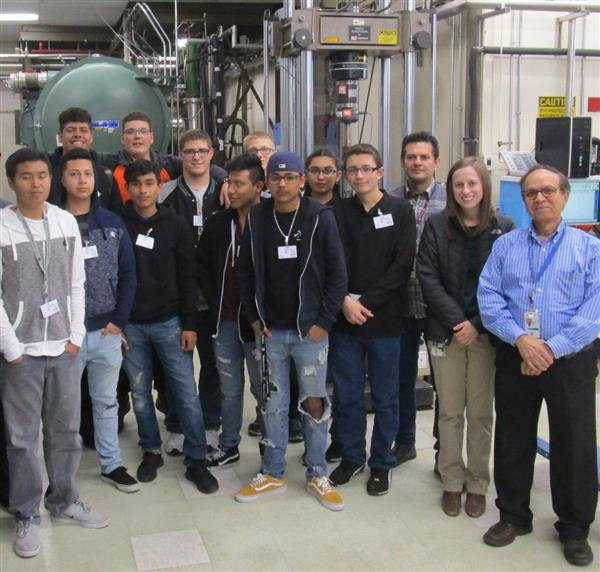 students on a tour of a local technology factory
