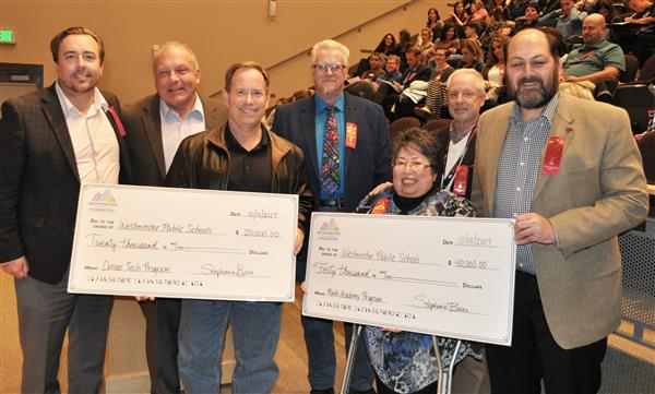 board members receive checks for CTE programs