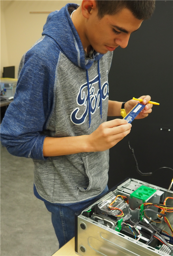 student working on building a computer
