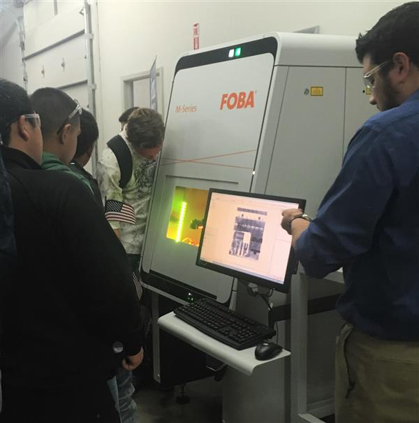 students participating in a tour of a 3D printing lab
