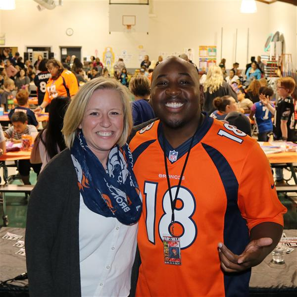 heather mcguire and dj a-rich pose for a photos at math night