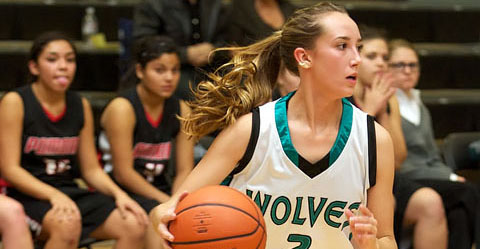 girl playing basketball for westminster high school