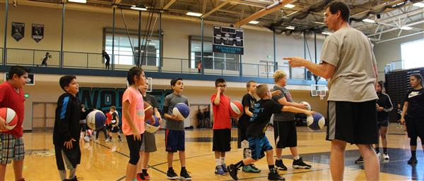 group of middle school students playing basketball