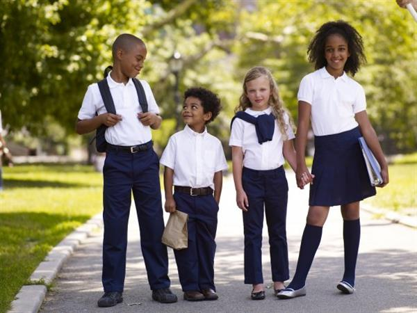 Image of four kids in school uniform