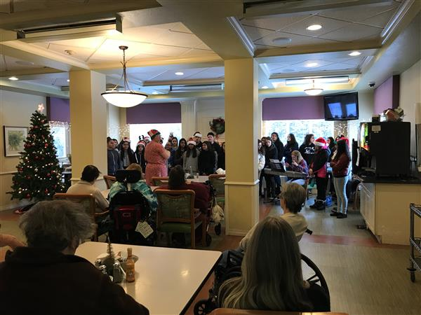 students caroling at the assisted living center
