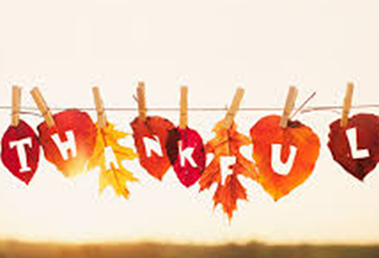 image of leaves on a clothes line and the text: thankful