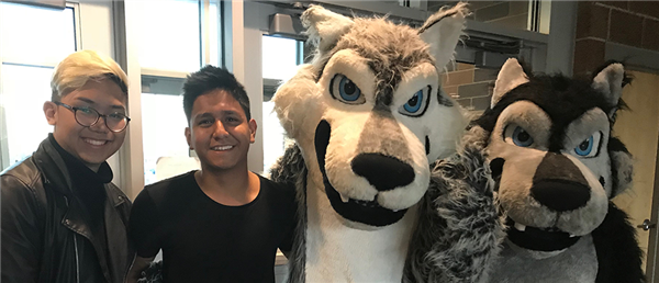 two boy high school students with the westminster high school wolves mascot