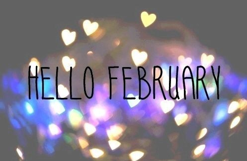 hello February in black font with hearts in bokeh effect in the background