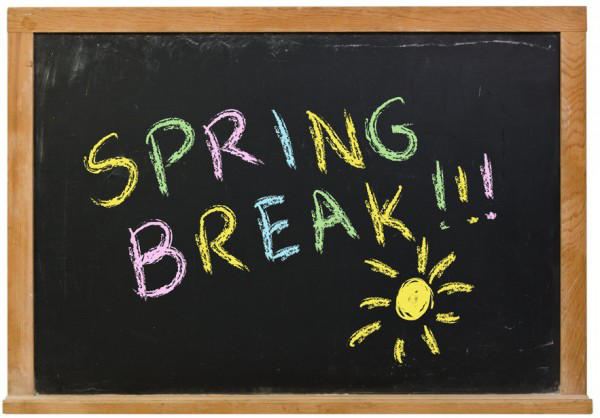 Black board with colorful sun and letters reading spring break!