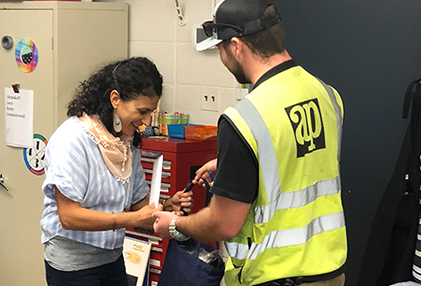 Teachers receives school supplies from A&P Construction worker
