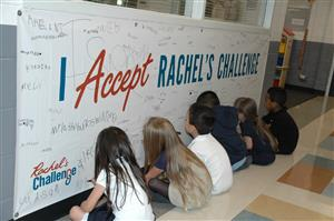 students signing a banner