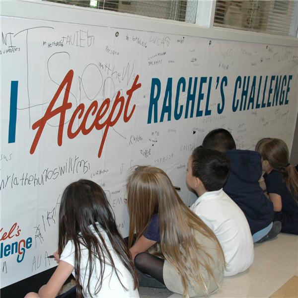 students signing banner
