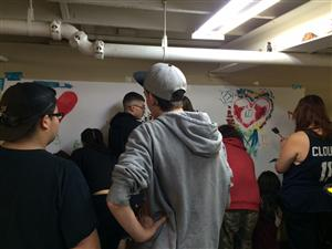 Students create a school culture mural
